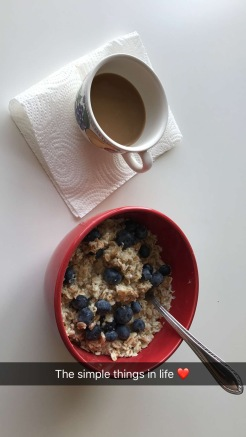 Oatmeal, blueberries, and coffee for breakfast.