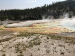 The Grand Prismatic Spring is surrounded by smaller pools and springs.