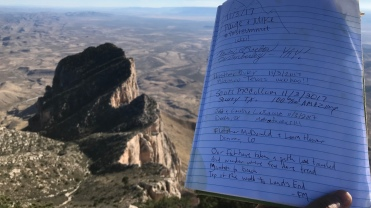 Hikers leave notes in the ledger along with dates and names.